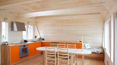 Hamran Kitchen. Extraordinary kitchens from Norway. Kitchen inspiration. Scandinavian design. Massive oak worktop. Lacquered mdf cabinets in orange. Gaggenau appliances.