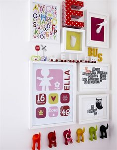 Bright pictures and fun hooks make a colourful display in a child's bedroom