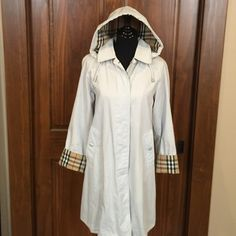 Authentic Burberry Rain Coat Excellent condition. No tears, stains, or piling. Rain coat fabric is mostly cotton. Removable hood with signature nova check pattern. Sleeves are foldable to show the lining as well. Will steam before shipping out. Coat does not have size but it fits like a S/M. I am a true size 6 and it fits me well. The color of the coat is a very very light sky blue. For reference I am 5'1 and the coat fits me as you can see in the photo. I don't wear it much so I'm selling…