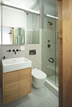 Marvelous Tiny Bathroom Ideas for Comfortable Relaxation Time: Chic Floating Vanity Tiny Bathroom With Wooden Vanity The White Sink Clear Mirror And The Glass Shower Room White Sink ~ SFXit Design Bathroom Inspiration