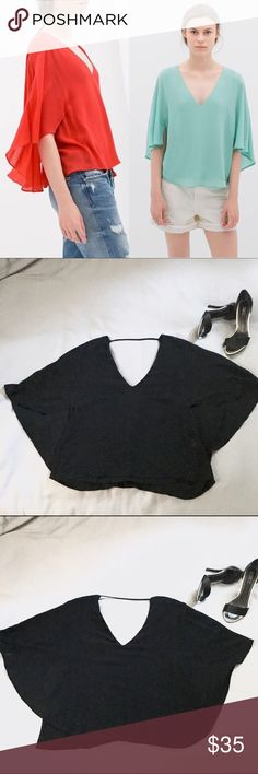 Black Zara Cape Blouse Black layered Zara top with double v-neck, back strap across the base of neck, and flowing cape back. Comfortable piece, dress it up or down. Perfect for a variety of occassions! Gently worn only a few times, no flaws. Zara Tops Blouses
