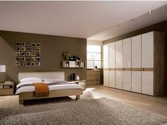 Bedroom Create a Small Bedroom Feel Larger: Elegant Bedroom Design With Wooden Bed And Mattress And White Bed Cover And Headboard And Wooden Chest Of Drawer And Table Lamp And Wooden Wardrobe And Wooden Floor With Grey Carpet