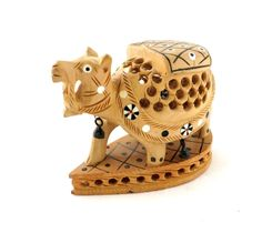 Nice build quality wooden camel shape statue toy,collectible. Very nice this piece decorative,collectible. Home decor. SIZE:- 3.5 x 1.7 x 3 inch. (L X W X H) Approx. Weight:- 0.200 gram.