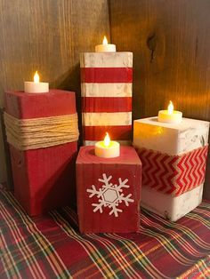 Cool Christmas Candle Decoration Ideas You'll Love Lovely red and white wooden candle holder for Christmas.Lovely red and white wooden candle holder for Christmas. Christmas Candle Decorations, Christmas Wood Crafts, Noel Christmas, Christmas Candles, Christmas Projects, Winter Christmas, Holiday Crafts, Homemade Decorations, Snow Decorations
