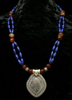 Moroccan Necklace with blue lapis lazuli, red carnelian beads and vintage silver pendant.