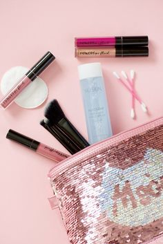 Nu Colour Makeup Remover on a pink surface with a sequin bag with an outline of a cat. Nu Skin, Beauty Essentials, Beauty Hacks, Maybelline, Waterproof Makeup Remover, Mascara, Long Lasting Makeup, Nail Polish, Free Makeup