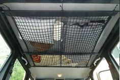 Use a traditional cargo net to add much needed storage to the ceiling in your RV. Works great for bunks, over the living area or in bedrooms....