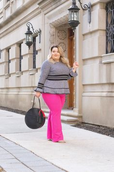 Chicago Plus Size Fashion Blogger Natalie Craig reviews Eloquii's Marled Sweater With Sporty Stripe And Flounce and the Victoria Beckham for Target Fuscia Twill Flared Trousers.