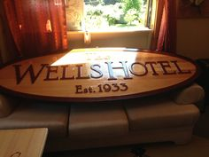 large wood carved and painted sign for a hotel in British Columbia, Canada