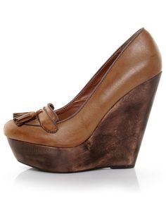 Jes!     http://www.lulus.com/products/angeles-lola-tan-tassel-platform-wedge-loafers/43651.html