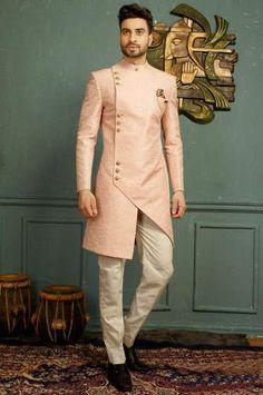 Buy Royal Pink Asymmetrical Indo Western Sherwani Online from Bodylinestore at best price. Select wide range of men's wedding sherwani, designer Sherwani for groom, traditional sherwani, jodhpuri Sherwani, sangeet sherwani and more. Mens Indian Wear, Mens Ethnic Wear, Indian Groom Wear, Indian Men Fashion, Mens Fashion Suits, Groom Fashion, Mens Suits, Sherwani For Men Wedding, Wedding Dresses Men Indian