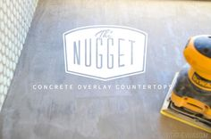 YAY!!! I was on to something thinking concrete...The Nugget: Refinishing The Countertops