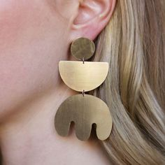 Lightweight, hand-cut statement earrings in gold plated brass with sterling silver ear posts. Measures 8cm high x 4.5cm wide. Handmade in our Melbourne studio.