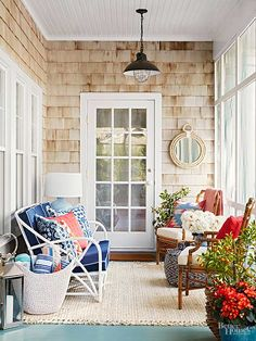 The key to making a totally cozy boho-vintage porch? Looking indoors for inspiration! Light weight furniture with outdoor fabric, enough repetition to tie the look together, and a great blend of bright colors in the pillows and lamp capture that boho vibe. This lounge-y screened-in porch is perfect for relaxing or having parties.