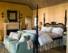 Beautiful master bedroom, wood post bed, stone fireplace and beautiful ceiling detail