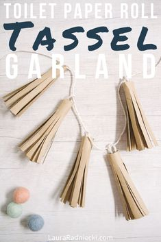 Learn how to make a toilet paper roll tassel garland using only recycled toilet paper tubes, scissors, hot glue, and string! They're fast, easy, and look surprisingly chic! #rusticchic #garland #diy #crafts #lauraradniecki