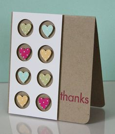 handmade thank-you card ... kraft base ... clean lines ... panel with negative space circles popped up from surface ... sweet punched heards from patterned paper fill the circles ... pleasing card ... Stampin' Up!