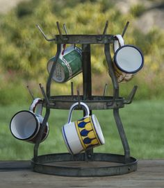 This is a vintage inspired French Bottle Drying Rack. It is hand finished and crafted from salvaged iron and galvanized zinc to create the perfect piece to display mugs. Measures 12″ in diameter by 15″ tall. - See more at: http://thecityfarm.com/product/french-bottle-drying-rack/#sthash.WxzgOBo3.dpuf