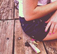 anchor shorts and pink nails.