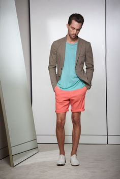 Shop this look on Lookastic:  https://lookastic.com/men/looks/grey-blazer-aquamarine-crew-neck-t-shirt-orange-shorts-grey-oxford-shoes/10346  — Aquamarine Crew-neck T-shirt  — Grey Blazer  — Orange Shorts  — Grey Leather Oxford Shoes