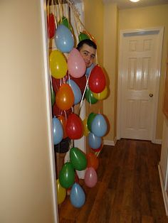 Make a balloon curtain for kids or spouse to wake up to on their birthday!