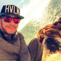 Roscoe enjoys one of his many beach days with his 'dad' Lewis, updating his legion of Inst...