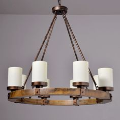 I like the candles and the kind of rustic look. Dining Pendant, Wood Chandelier, Wall Lights, Ceiling Lights, Iron Chandeliers, Wood Rounds, Vintage Iron, Candle Making, Vintage Industrial