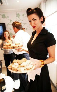 Vintage-style waitress serving up sandwiches