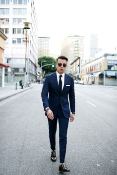 Navy suit + black tie + white pocket square + double monk strap shoes