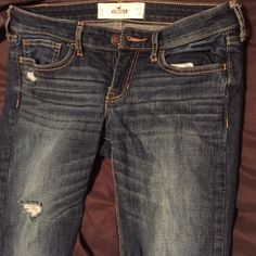 Hollister Boot Cut Jeans Dark, faded wash, skinny boot cut jeans with holes. Only worn once. Bundle and save 20%! Hollister Jeans Boot Cut