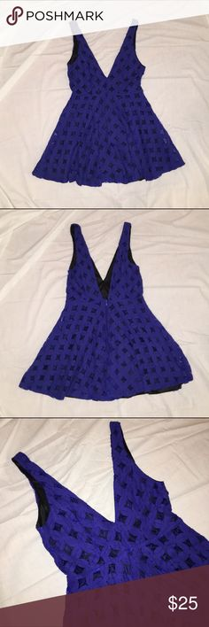 "Blue Dress with a Plunging Neckline Cute blue dress with a black inner lining. The neckline is a deep v and the back is the same way. Very gently used and perfect for a night out! The length of the skirt is 16"" and the fabric is 65% cotton, 35% polyester. finn & clover Dresses Mini"