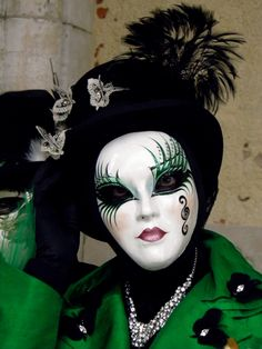 Venice Carnival 2013 by Lesley McGibbon - carnival goer in green with different mask