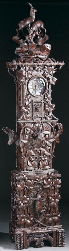 A Swiss Carved Black Forest Tall Case Clock, circa 1900.