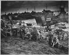 Feb. 19, 1945, 69 years ago today, U.S. Marines invaded Iwo Jima beginning five weeks of fighting that will forever be remembered as one of the most brutal battles in the Pacific theatre during #WorldWarII. Here's an image from that day: U.S. Marines unload supplies from U.S. Navy and U.S. Coast Guard landing craft onto the sands of Iwo Jima a few hours after they had taken the beach, Feb. 19, 1945. (US National Archives photo/Released)