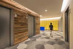 Reclaimed wood elevator lobby with a pop of bright color | Wright Heerema Architects | Design Inspiration | James Steinkamp Photography