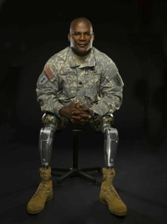 Colonel Gregory D. Gadson, Director of the U.S. Army Wounded Warrior Program.  More than 20 years service and served in every major conflict of the last two decades.  COL Gadson was severely injured by an IED, lost both legs above the knee, and severe damage to the right arm.  This is not a sad story.  It is a story of a hero and a soldier.  DONATE TO WOUNDED WARRIORS!