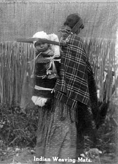An old photograph of a Native American Woman Weaving Rush Mats at Mille Lacs with a Baby in a Cradle on her Back. Native American Photos, Native American Tribes, Native American History, Walk In The Spirit, Native Indian, Babywearing, Nativity, Native Place, Sioux