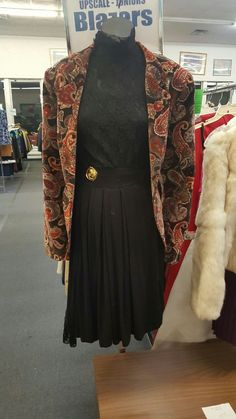 Vintage jacket, top, and skirt at our Monroeville store