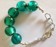 #bracciale in #metallo con #vetro #tondo #verde. su www.ro18.eu #oro18 #bigiotteria #bijoux  info@oro18.eu euro 14,90