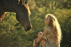 curly hair girl field horse