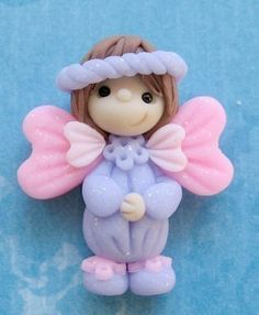 Angel - ok so I got this of a cake decorating site but...she is just so cute...gonna make her with clay :)