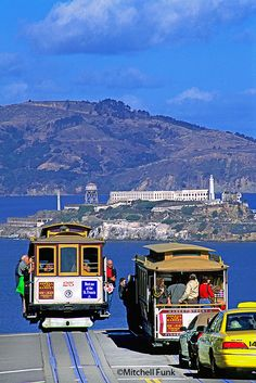 Two Cable Car On Hyde Street In Alcatraz In Background www.mitchellfunk.com