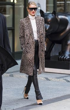 Here she comes: Rosie Huntington-Whiteley proved her supermodel status on Thursday, as she made an incredibly chic arrival in New York City