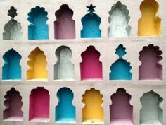 The Colorful Wall #Wallart #beautiful #Indian #ethnic #engravings #shapes #tombs #carvings #wall #home #decor #musttry