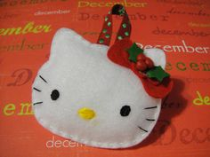 Handmade Felt Hello Kitty Christmas Ornament with Holly Leaf Embellishment: With Optional Personalization. $6.50, via Etsy.