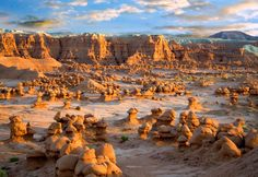 Goblin Valley State Park in southern Utah. Sandstone erosion made the shapes; the small, spherical shapes of the goblins combine with the hoodoos, rock pinnacles in the shape of mushrooms, to give the landscape an eerie edge.