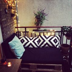 Balcony in Copenhagen, Nørrebro. Make a comfortable couch out of pallets and a cheap mattress from IKEA.