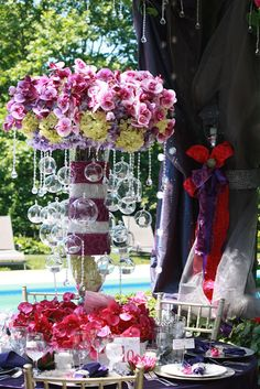 Poolside summer wedding table by Village Vines Floral and Event Design