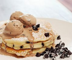 chocolate chip pancakes with chocolate ice cream, powdered sugar, and chocolate chips