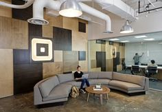 Amazing wall texture, logo, reception, and conference area at Square. Perfection.